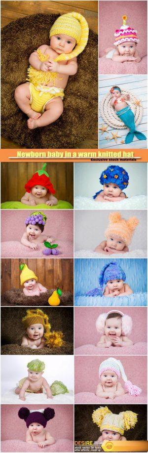 Newborn baby in a warm knitted hat