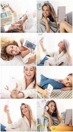 Happy woman taking selfie in bed 8X JPEG