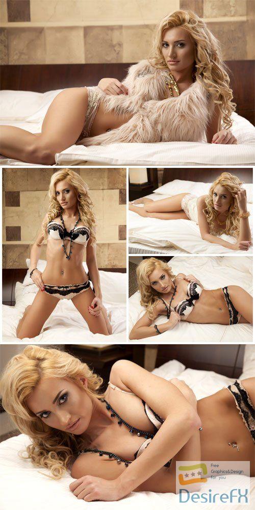 Girl posing on bed romantic stock photo