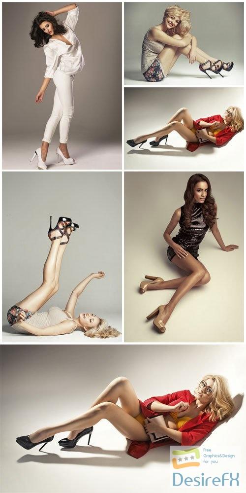 Fashionable girls posing in studio stock photo