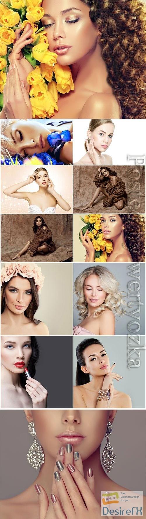 Beautiful girls posing with flowers stock photo