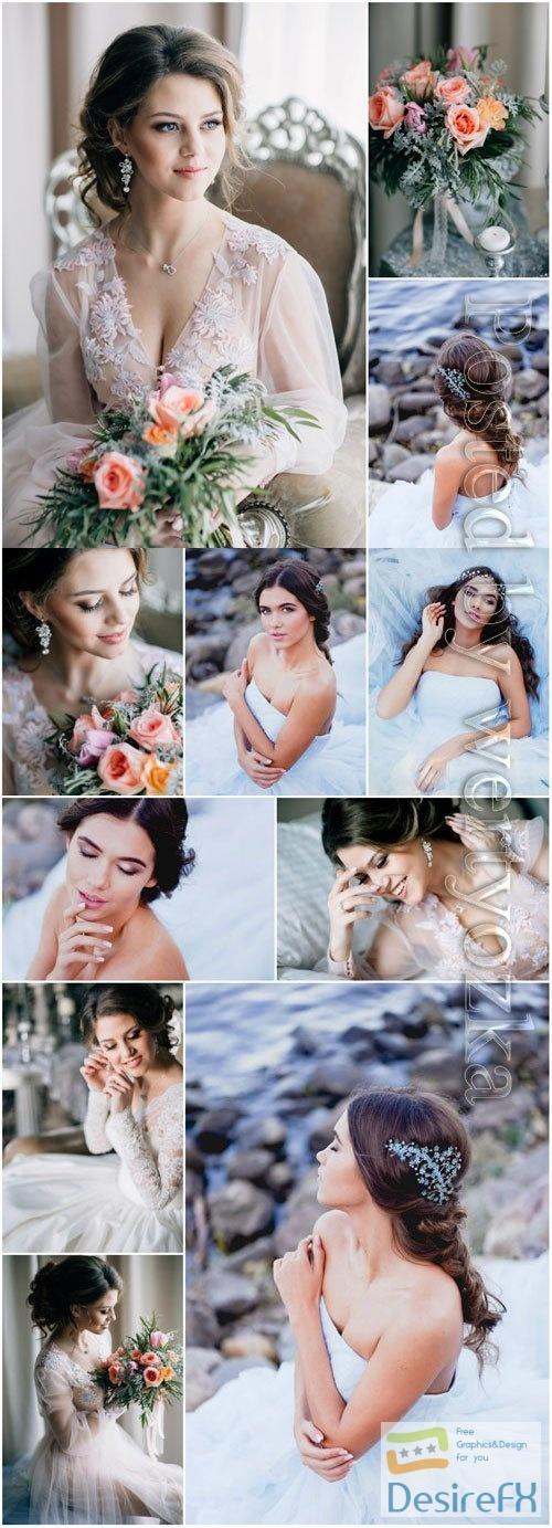 Brides in wedding dresses posing stock photo