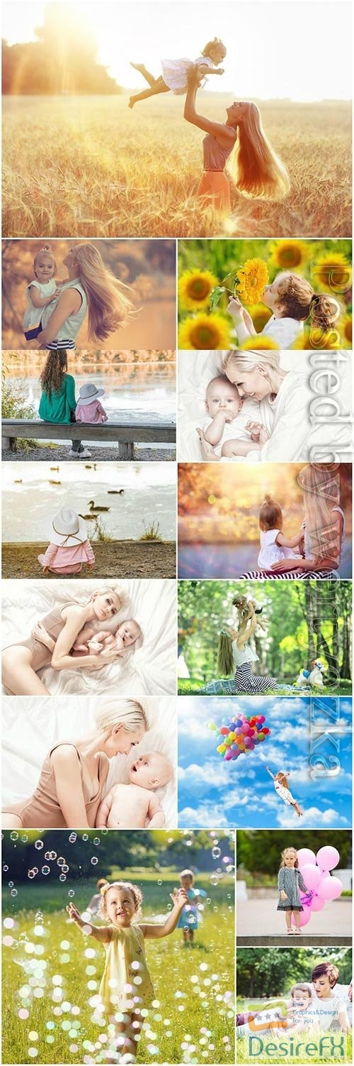 Children with mothers in nature stock photo