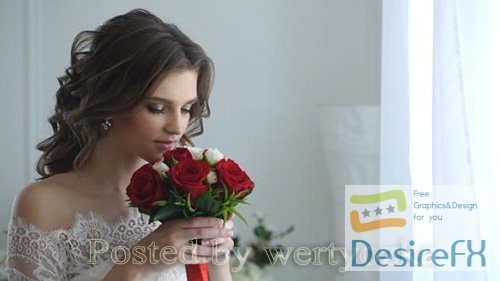 Beautiful Bride Smelling Wedding Bouquet
