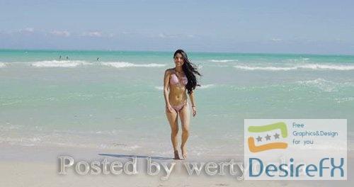 Delight Girl in Bikini Walking on Beach