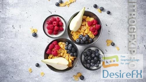 Golden Cornflakes with Fresh Fruits of Raspberries Blueberries and Pear in Ceramic Bowl